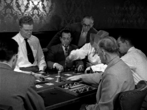Players sitting around Faro table Case keeper w/ case counter FG Dealer across table w/ card box game being played Gaming games gambling cards wager