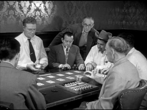players sitting around faro table case keeper w/ case counter fg dealer across table w/ card box game being played gaming games gambling cards... - card table stock videos & royalty-free footage