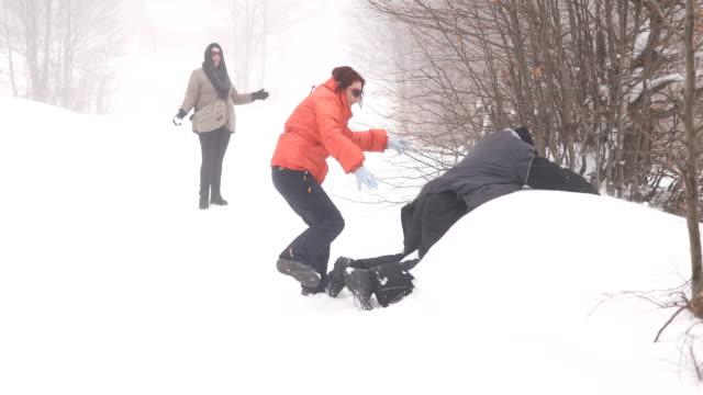 Playful adults having fun on snow