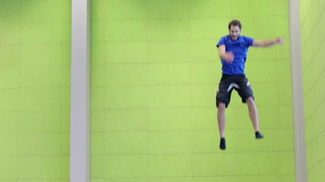 playful athlete on trampoline - upside down stock videos & royalty-free footage