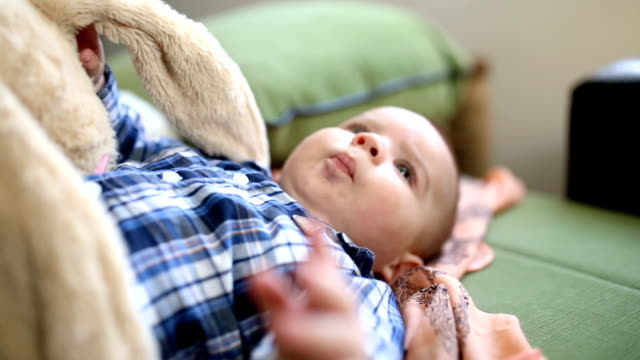 playful baby boy - soft toy stock videos & royalty-free footage