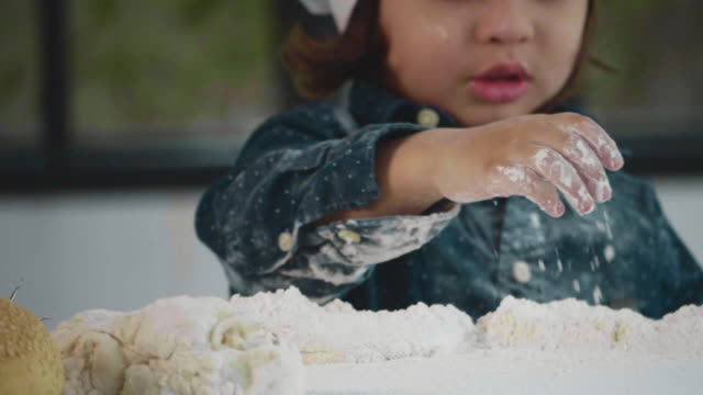 playful boy clapping hands with flour - chef's hat stock videos & royalty-free footage