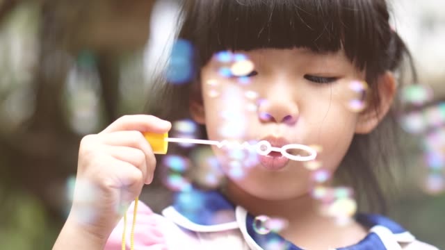 playful bubbles - bubble wand stock videos & royalty-free footage