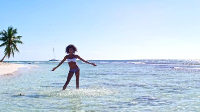 playful caribbean woman - caribbean sea stock videos & royalty-free footage