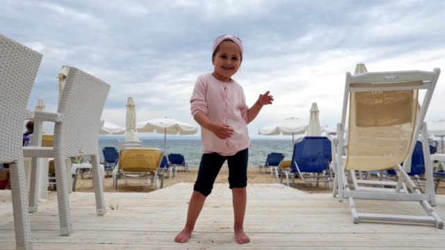 playful child dancing on the beach - beach holiday stock videos & royalty-free footage