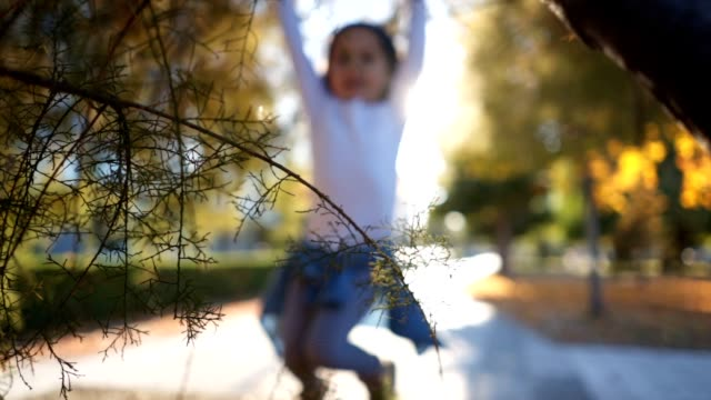 playful child hanging on a tree branch - defocussed stock videos & royalty-free footage
