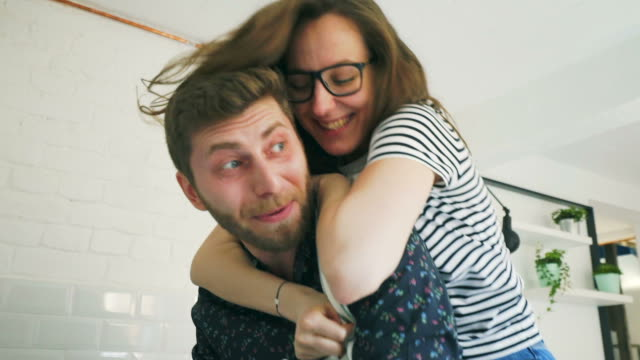 playful couple in the kitchen. - young couple stock videos & royalty-free footage