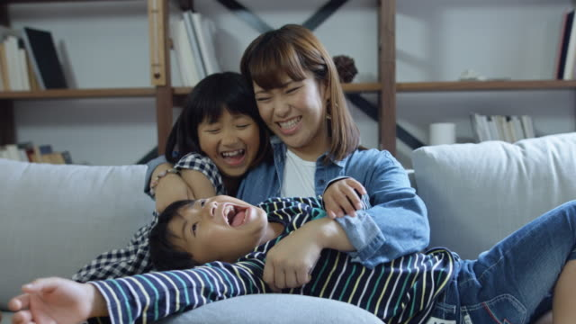 playful family embracing on couch - only japanese stock videos & royalty-free footage