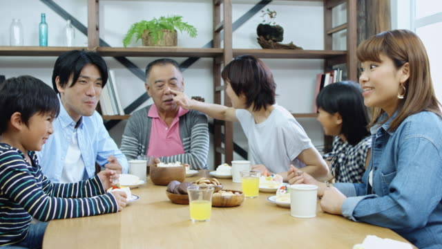 playful family enjoying dinner - breakfast table stock videos and b-roll footage