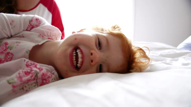 playful family morning - double bed stock videos & royalty-free footage