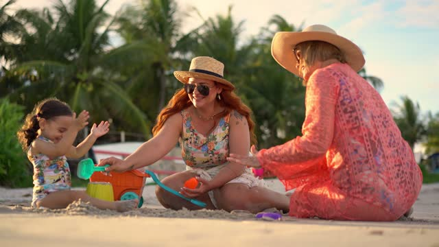 playful family sitting on the beach sand - tropical climate stock videos & royalty-free footage