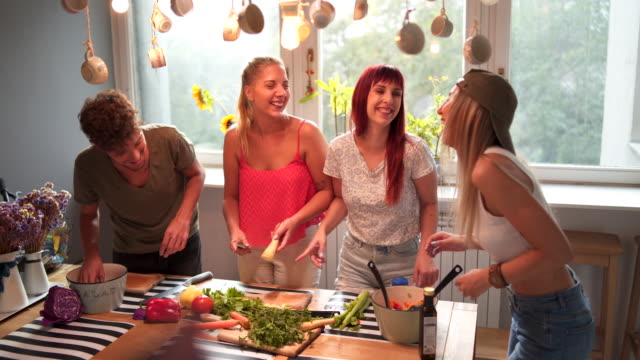 playful friends playing with vegetables in kitchen - amicizia tra donne video stock e b–roll