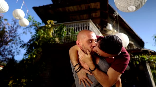 playful gay couple piggybacking in the yard - falling in love stock videos & royalty-free footage