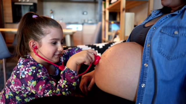 playful girl listening to her mother abdomen - prenatal care stock videos & royalty-free footage