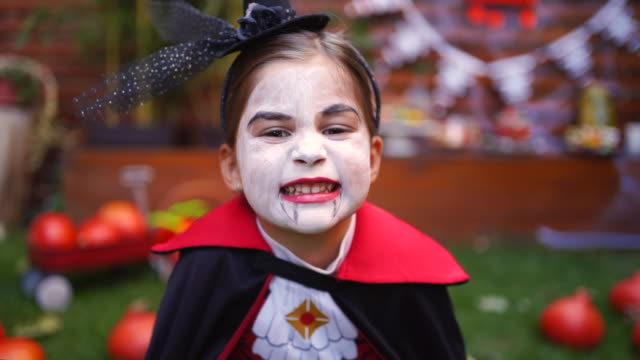 playful kids enjoying a halloween party - count dracula stock videos & royalty-free footage