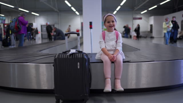 playful little girl at the airport - airport terminal stock videos & royalty-free footage