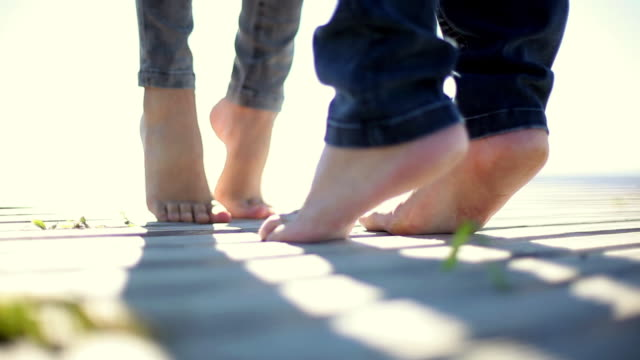 playful lovers kiss standing on tiptoe - tiptoe stock videos & royalty-free footage