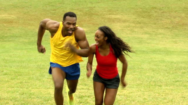 playful male and female athletes run up hill - endurance stock videos & royalty-free footage