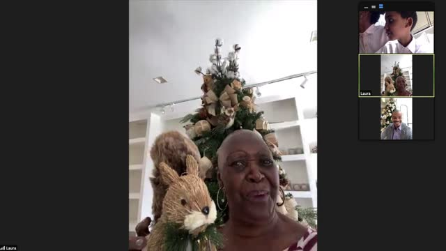 playful senior woman on a video chat with friends during christmas - virtual event stock videos & royalty-free footage