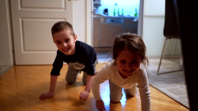 playful siblings crawling and clowning at home - crawling stock videos & royalty-free footage