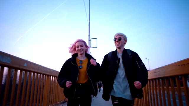 playful teen couple running - pink hair stock videos & royalty-free footage