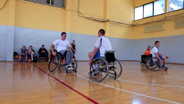 playful wheelchair athletes having fun during training - disability stock videos & royalty-free footage