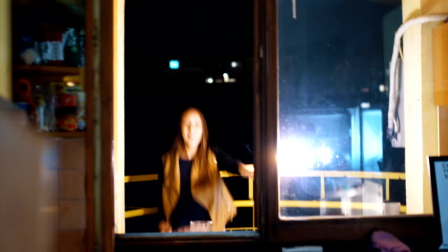playful woman dance and hold a flaming torch - balcony stock videos & royalty-free footage