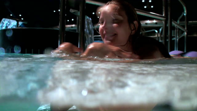 playful woman enjoying in a wellness pool; underwater camera - covering stock videos and b-roll footage