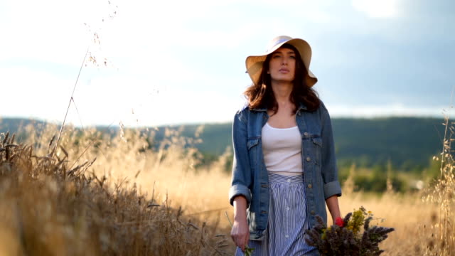 playful woman enjoying nature - cappello video stock e b–roll