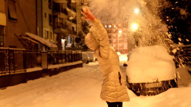Playful woman enjoying snow