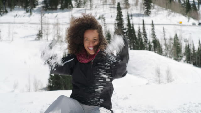 playful woman in winter mountain snow - mixed race person stock videos & royalty-free footage
