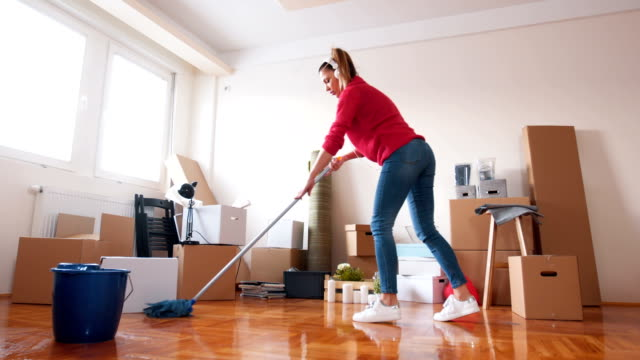Playful woman mopping the floor
