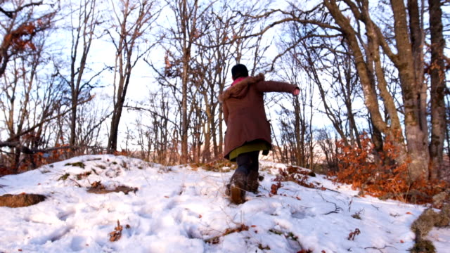 playful woman running through mountain forest - admiration stock videos and b-roll footage