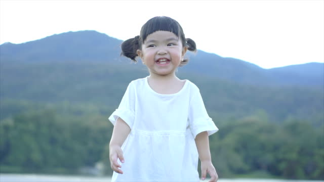 slomo playful young girl jumping and dancing - chinese ethnicity stock videos & royalty-free footage