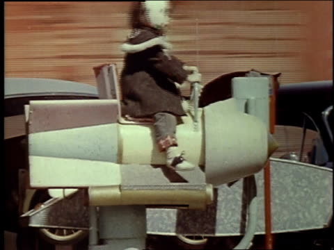 1957 montage playground rides, children climbing into rocket-type kiddie rides, including, 'sputnik.' / brussels, belgium - sputnik stock videos & royalty-free footage