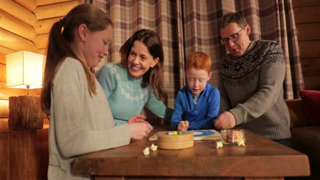 playing a board game with the family - winter stock videos & royalty-free footage