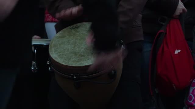 Playing a bongo