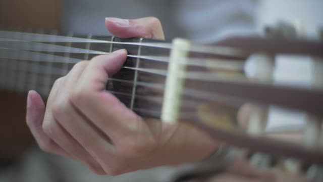 Playing accoustic guitar