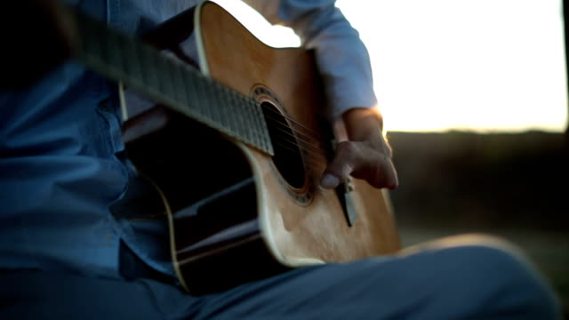 playing acoustic guitar in sunset - disability stock videos & royalty-free footage