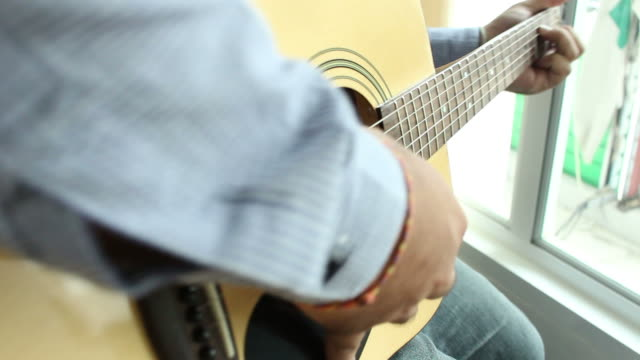 playing acoustic guitar - fretboard stock videos and b-roll footage