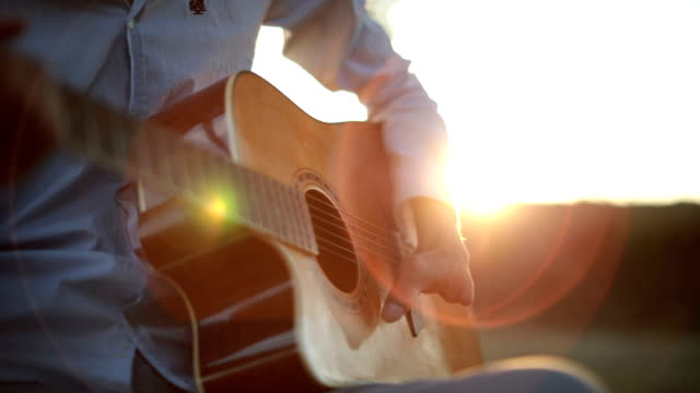playing acoustic guitar - guitarist stock videos & royalty-free footage