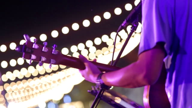 playing an electric guitar at concert party - acoustic guitar stock videos and b-roll footage