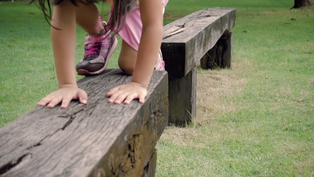 playing at the park. thailand - baby girls stock videos & royalty-free footage