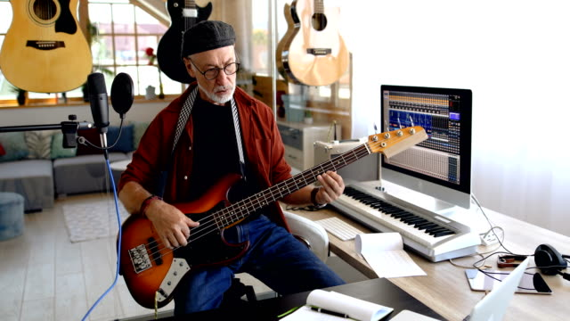 playing bass guitar at home - rock musician stock videos & royalty-free footage