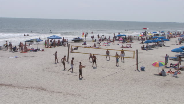 ha playing beach volleyball game / folly beach, south carolina, united states - carolina beach stock videos & royalty-free footage