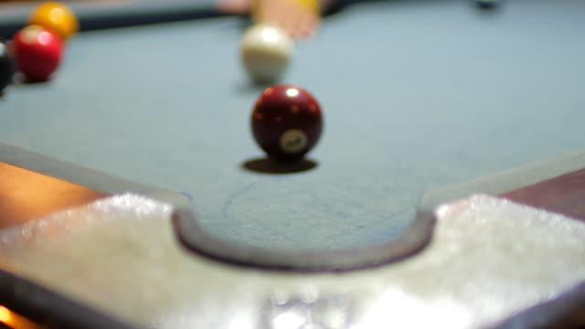 playing billiard balls pool game on pool table at pub , 4k(uhd) - pocket stock videos & royalty-free footage