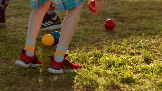 playing bocce game in the park - toy stock videos & royalty-free footage