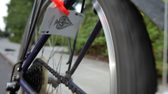a playing card is caught in bicycle spokes in seattle, washington. - suit stock videos & royalty-free footage