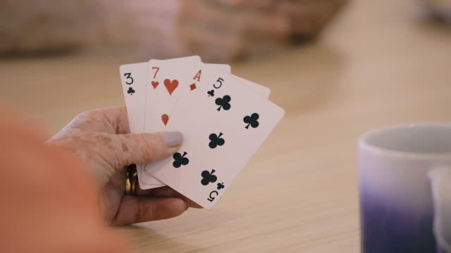 playing cards - close up poker hand - hand of cards stock videos & royalty-free footage