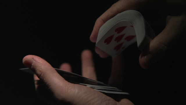 cu playing cards flicked into hand - hand of cards stock videos & royalty-free footage